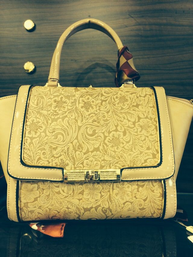 bag with lacework , cream style