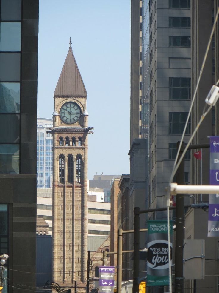 The Clock Tower of Toronto's Old City Hall contrasting with the more modern buildings around it