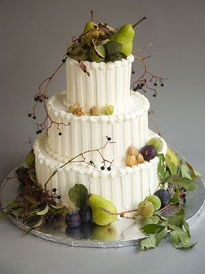 Wedding cake with marzipan pears, apples and berries