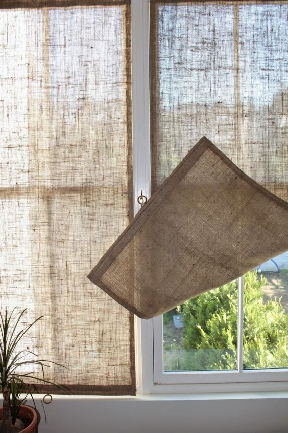 DIY: How to Make Burlap Window Panels - using burlap, a dowel, thread, a metal ring and a cleat. This is a great look and an easy beginner's project - by Caitlin Long, via Remodelista