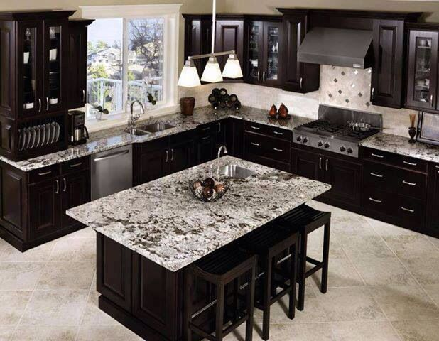 Dark cabinets with light flooring and countertops