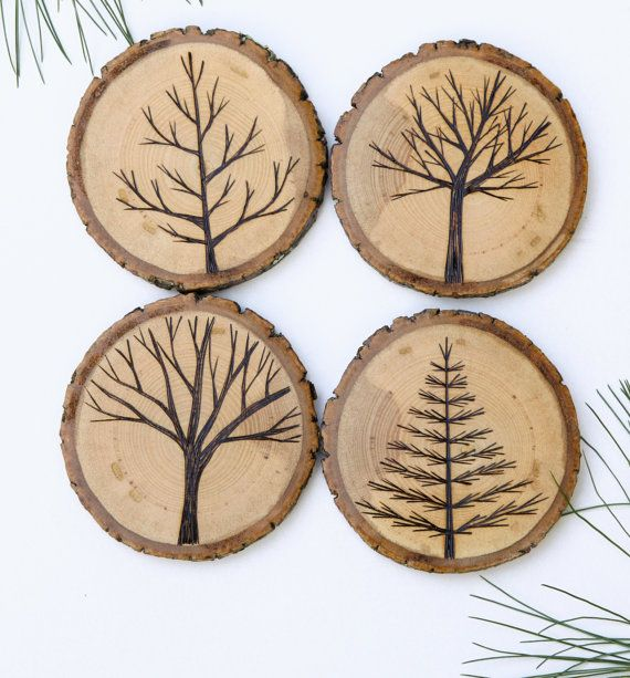 Set of 4 Wood Burned Tree Coasters by ForageWorkshop on Etsy. hooked up with the table cloth. Nice simple clear designs ;)