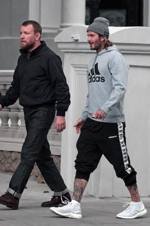 David Beckham wearing  Adidas TNT Trefoil Wind Pants, Adidas Essential Hoodie, Adidas Pureboost