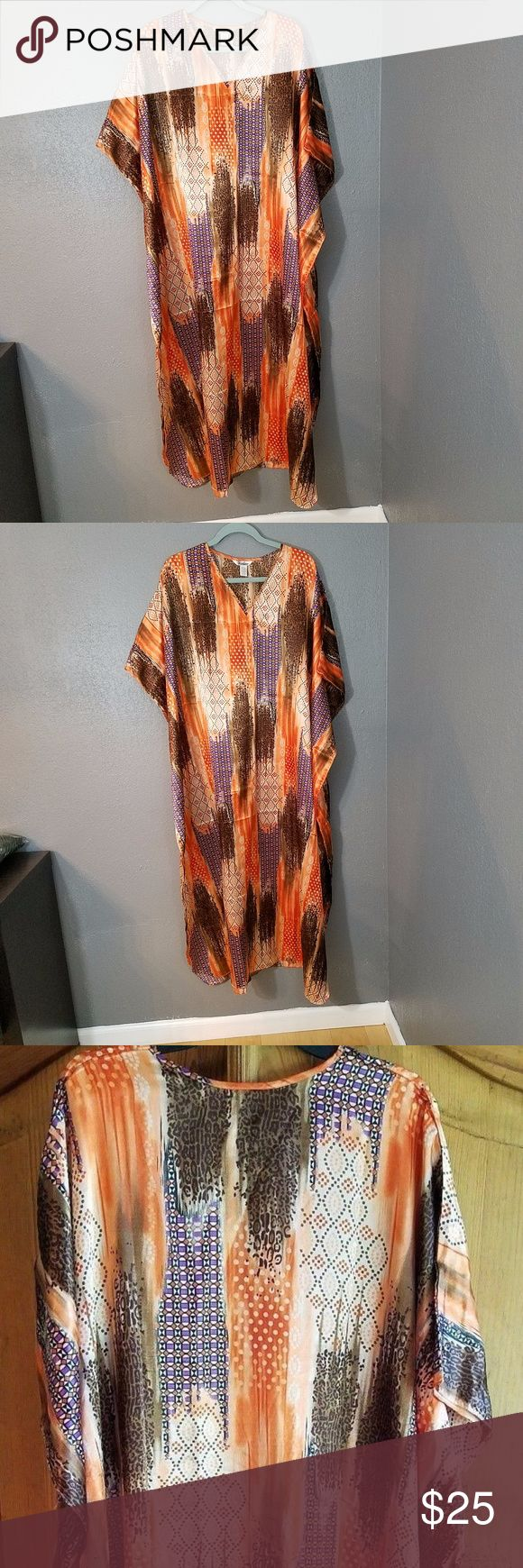 "Winlar Caftan Animal Print OS WINLAR CAFTAN Muumuu dress. It is orange and browns. Has several different patterns, please take a look at the pictures.  Some animal print, dots, and more.  It is One size fits most. In gently used good condition. No rips or stains. This is one of three that I have listed. Please take a look at my store.  About 42"" shoulder to shoulder.  Neck to hem is about 52"".  There is a slit on both sides at the bottom of about 18"".   There is a seam down the side about…"