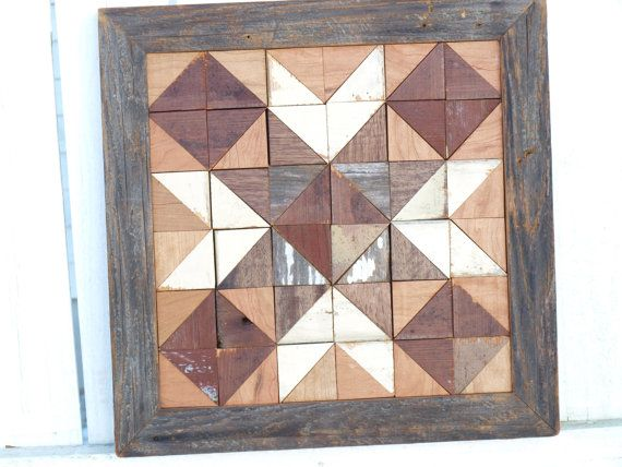 This classic wooden quilt is perfect for barn lovers like me! Its completely handmade using hand harvested salvaged faded grey barn boards with hints of remnants of old white paint, burgundy colored boards that were salvage from an antique store in northern Illinois, reclaimed boards that came from an historic home in a Mississippi river town that had been long ago painted an off white and cherry that was hand sawn from local felled trees. This quilt block is approx. 15 1/2 X 15...