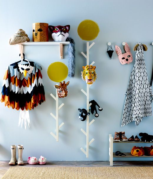 Animal dress up clothes hanging in a hallway