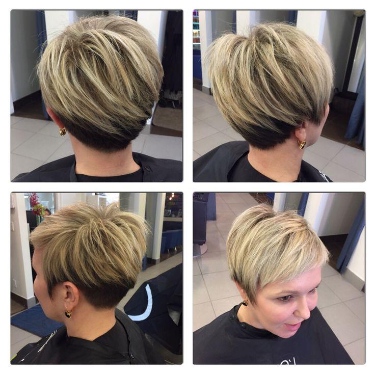 Hair by Paulina.  Asymmetrical disconnected cut