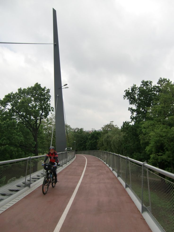 "Rob crosses one of the cool (and very expensive) bridges on the new bike path.   It's been called ""Europe's most expensive bike path.""  And..."