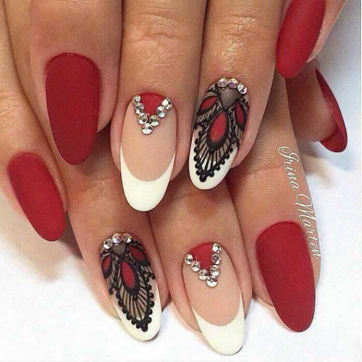 Long red hussy tipped nails in antique red, white and beautiful designs #nails #design #beauty