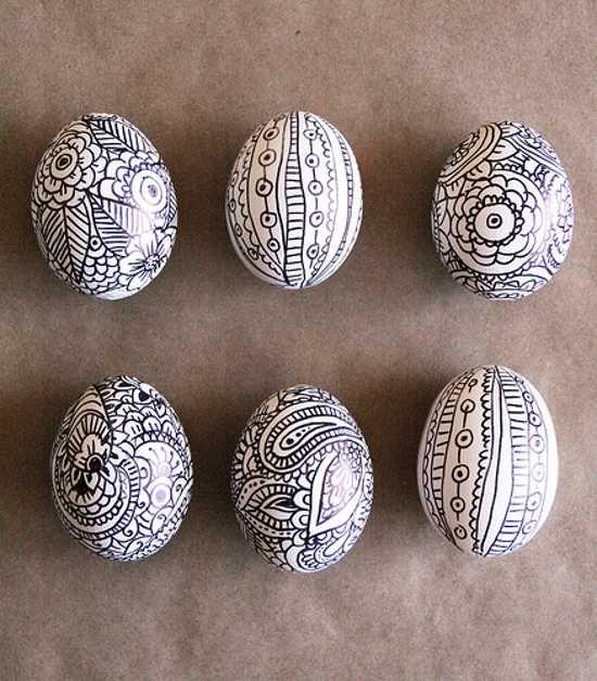 black marker drawing on white egg