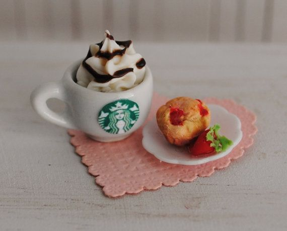 Miniature Latte' With Whipped Cream And Chocolate And A Plate With A Strawberry Muffin And A Strawberry