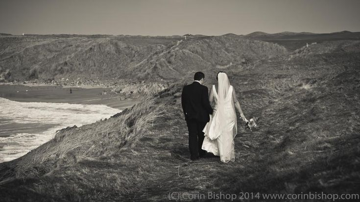 Bride and Groom walking along the cliffs