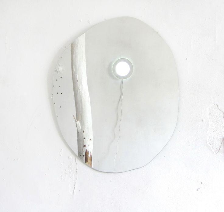 round lamp. сurved mirror.