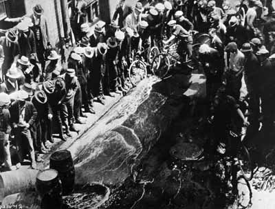 Enforcing Prohibition was often a sensational public event. In this photo, barrels of contraband beer are poured out into the streets.    Prohibition Pictures : Discovery Channel