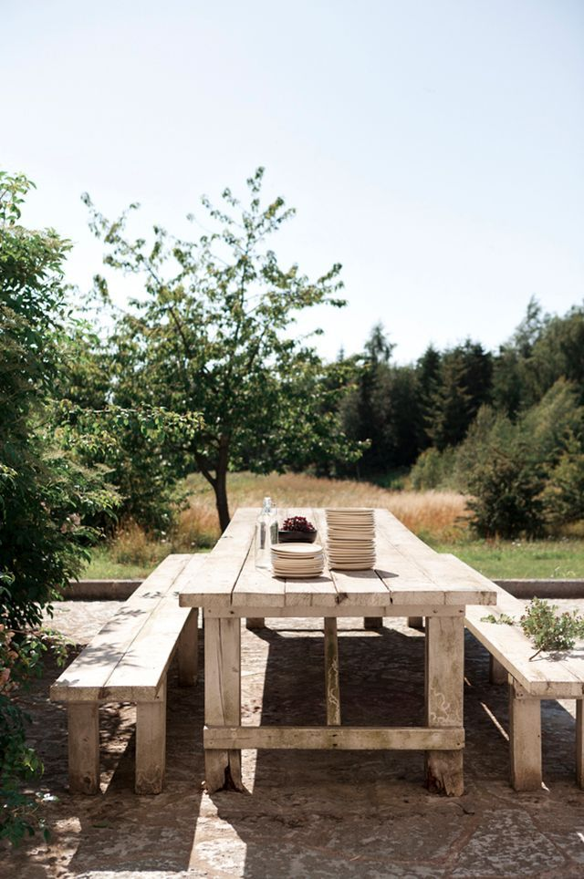 Sheila wooden table outdoors-Beautiful renovation: Old farm in cozy Scandinavian loft (via Bloglovin.com )