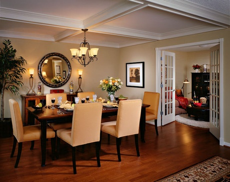Peach-colored chairs, a white coffered ceiling and French doors to the adjoining room create a crisp look. The Iroquois Club new home community. Naperville, IL.