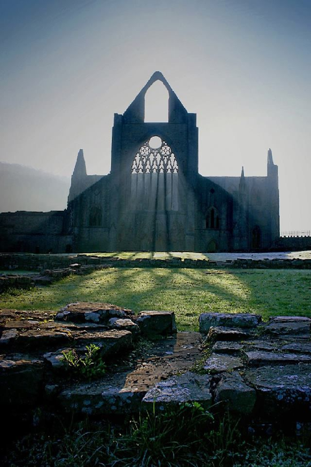 Beams of light illuminate the ruins of Tintern Abbey, Tintern, Monmouthshire, Wales.