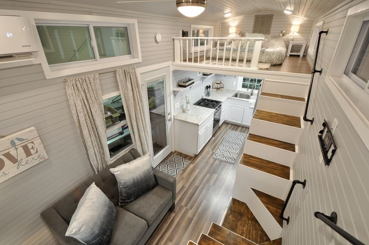 This is the gorgeous Kate by Tiny House Building Company that's for sale! The inside of this tiny house on wheels is absolutely stunning. The home features two queen-sized lofts accessible by…