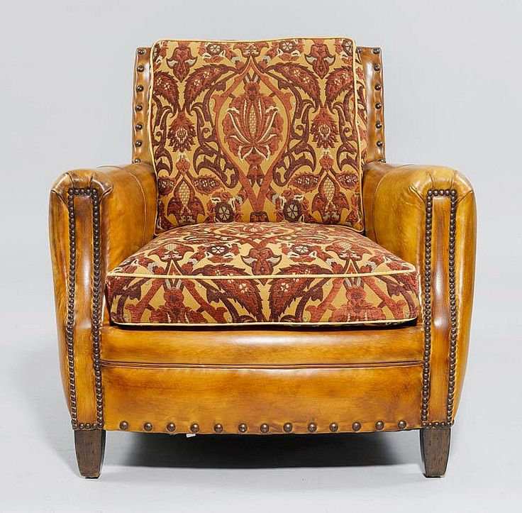 A CLUB ARMCHAIR, in the style of the 1930ies.