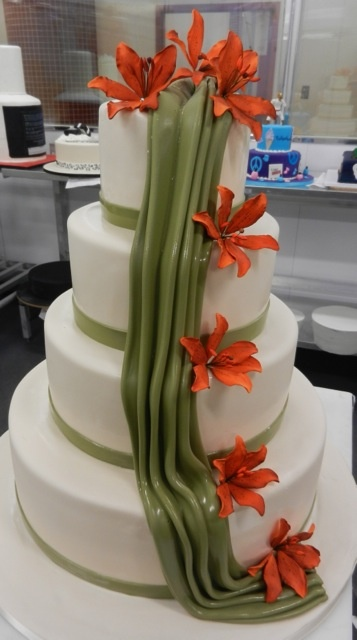 Orange flowers with olive green fondant draping