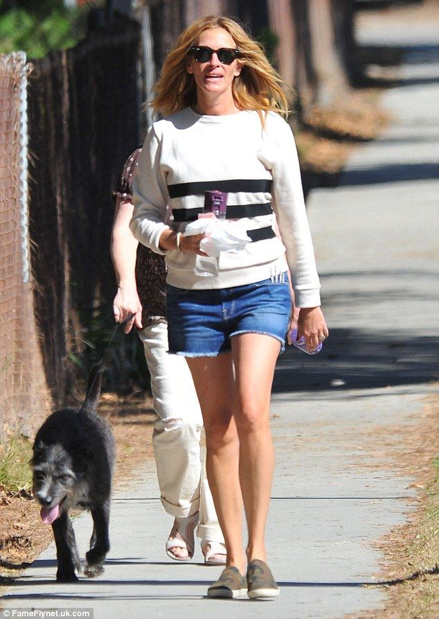 Walking the dog: Julia Roberts showed off her incredibly shapely legs as she took her dog for a walk with a pal in Malibu, California on Sunday