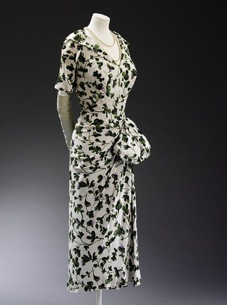Dress with swag    Place of origin:  Paris, France (made)    Date:  1949 (made)    Artist/Maker:  Jacques Fath, born 1912 - died 1954 (designer)    Materials and Techniques:  Printed viscose rayon and silk, semi-lined    Credit Line:  Given by Lady Alexandra Trevor-Roper    Museum number:  T.179    Gallery location:  In Storage