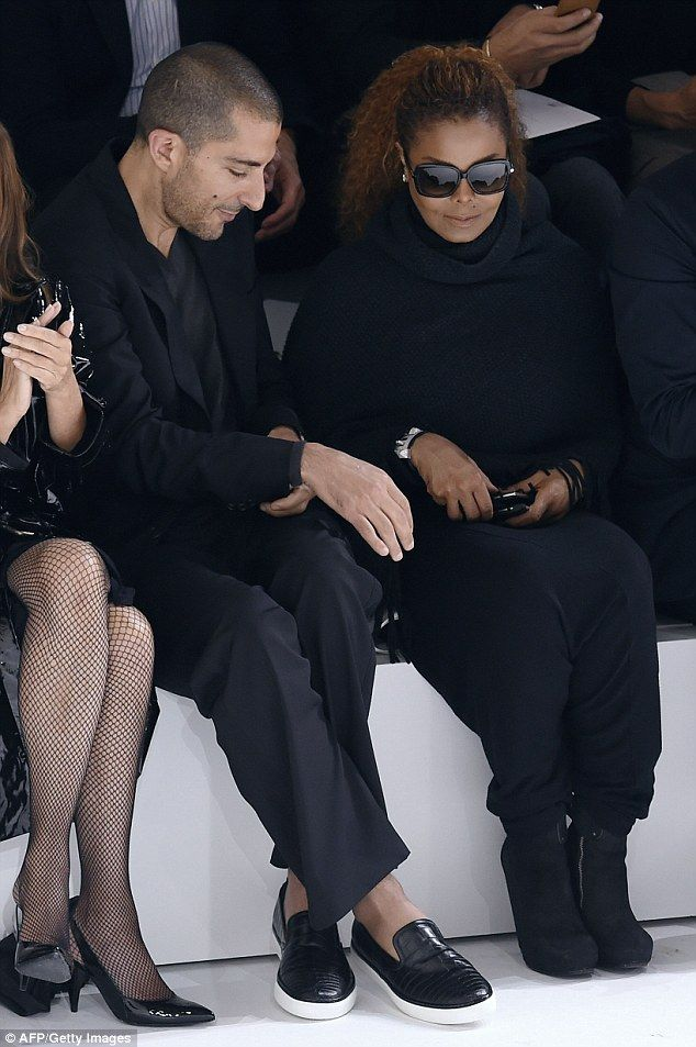 Loved-up: Janet Jackson, 49, and her husband Wissam Al Mana, 40, put on a cosy display as ...