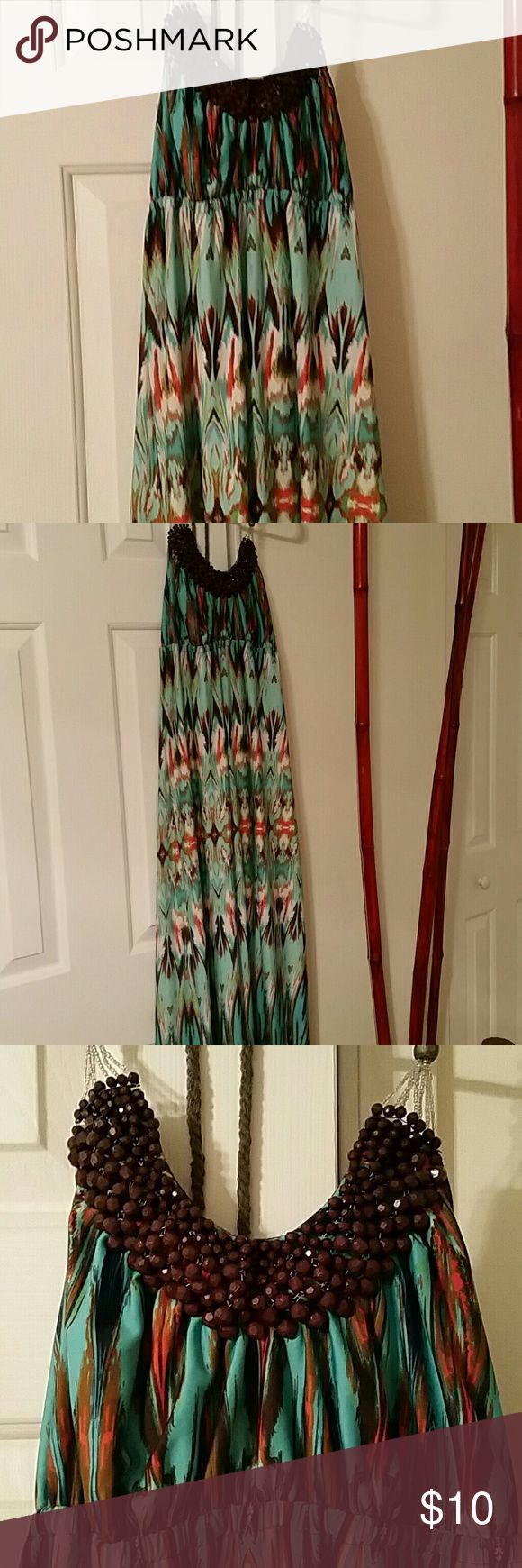 Maxi dress Beautiful beaded neckline orange, teal and brown maxi dress. Ties around the neck, halter style. Size medium. Like new. Dresses Maxi
