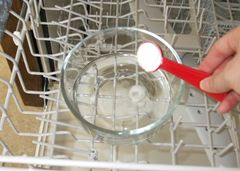 Clean dishwasher with 1 cup vinegar, 1 T baking soda and run on hottest cycle.