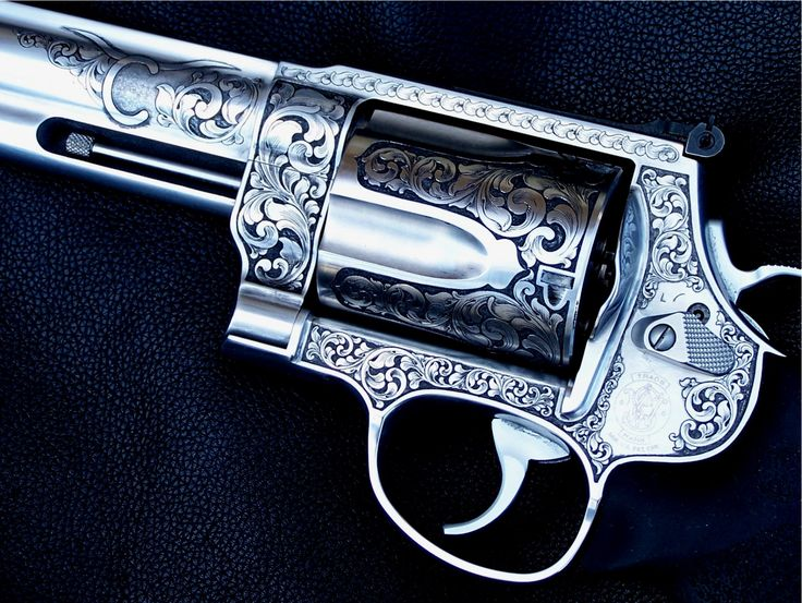 Smith & Wesson .XVR  460 Magnum.  By Otto Carter- a Master Engraver.