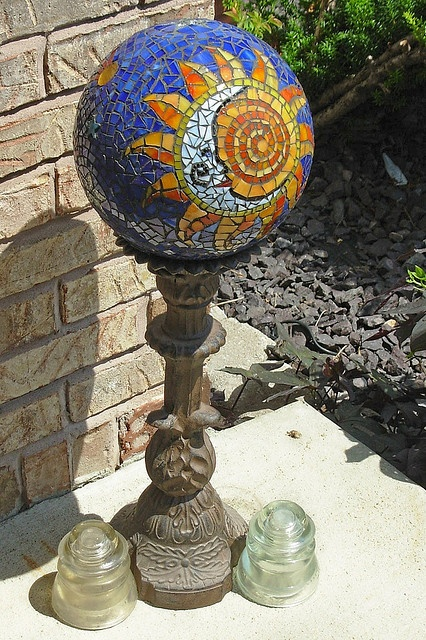 Sun/Moon Gazing Ball by Gray Dog 2010, via Flickr  I bet I could learn to make one of these!