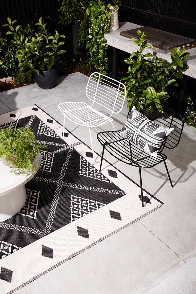 Racket Easy Chair White and Black  Sphere Coffee table - Styling and Art Direction by Moore Concepts and Greenhouse Interiors  Photography by Armelle Habib /// . Cushion - Merci Perci. Maidenhair Fern - Glasshaus nurseries. Shrubs in black pots - Gils Nursery