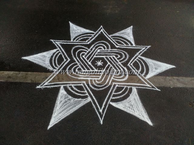 White kolam design done in free hand style ..... you can do this in your entrance with bright colours ..........