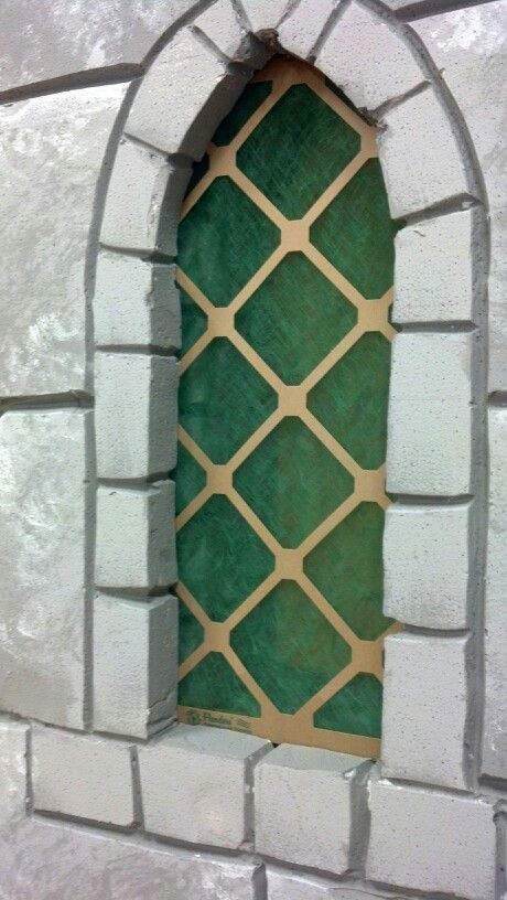 Foam + a cheap air filter = the perfect castle window. This would be a great idea for the way to the dungeon.