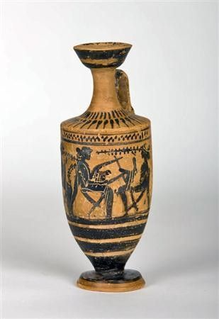 Greek Attic black figured Lekythos, 5th century B.C. Pottery oil jar decorated with three seated female musician figures, the central figure playing a lyre, 19 cm high. Private collection