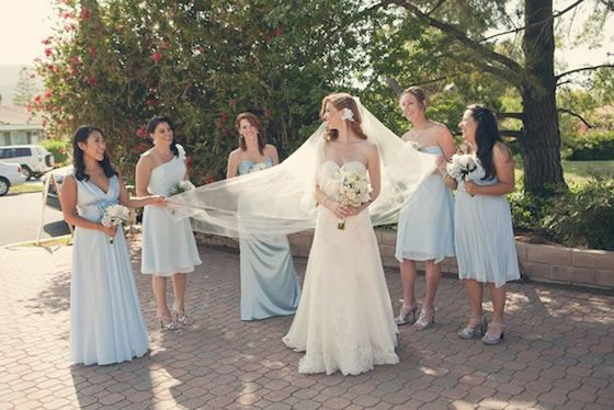 Powder blue bridesmaid dresses in different lengths and styles.