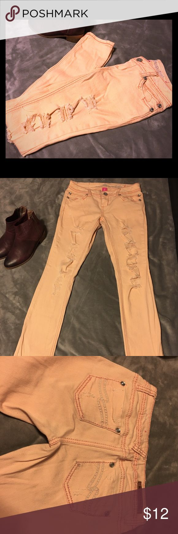 Distressed coral boot cut jeans Pre loved. No stains or tears. These jeans stretch and are very comfortable. They are more like a low rise. Comes from smoke free, pet free home. Shipping dates are Tuesday through Friday Almost Famous Jeans Boot Cut