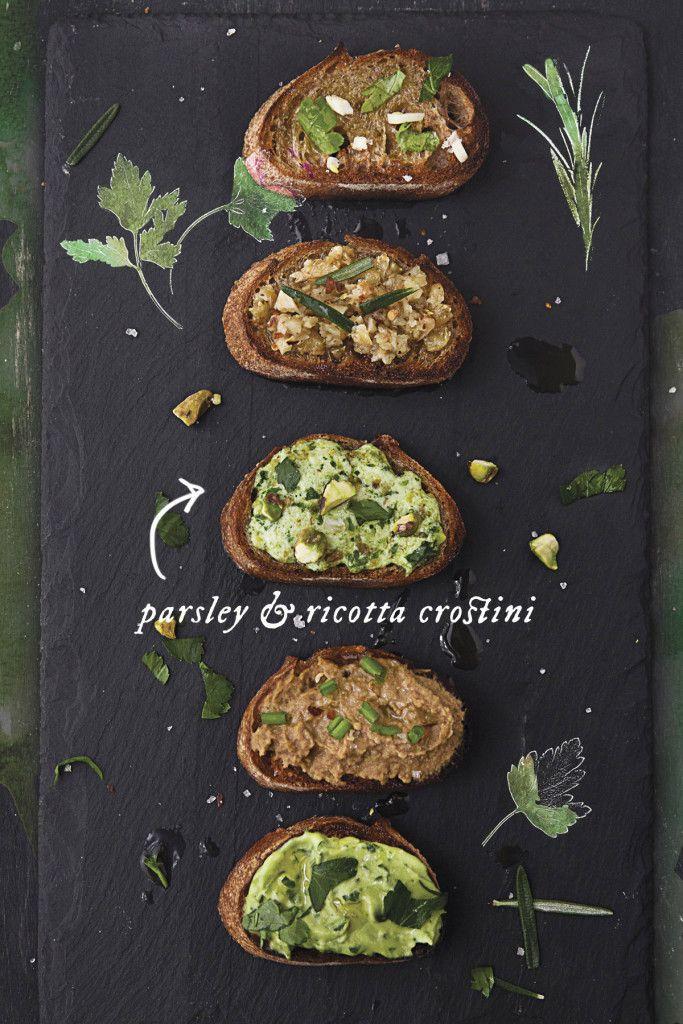 Parsley and Ricotta Pesto Crostini feature Colavita Olive Oil mixed into creamy…