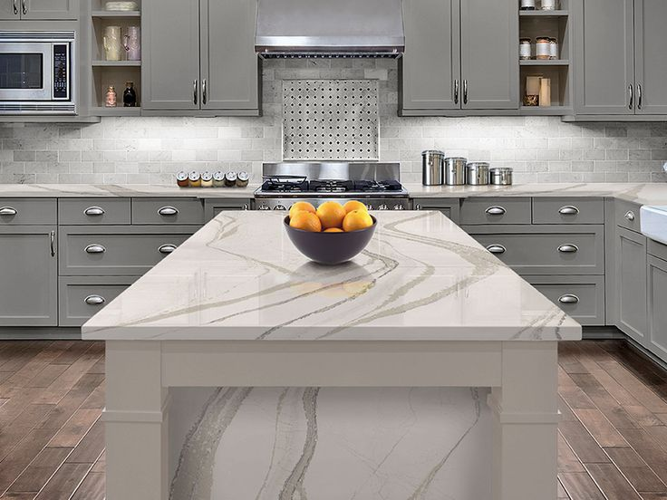 Britannica's wave-like pattern relaxes this kitchen with its warm gray tones.