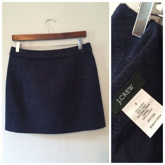 """J. Crew Navy Shimmer Skirt Excellent condition. Midnight blue skirt with silver threads creating a shimmer effect all over. Fully lined. 73% cotton and 24% linen with 100% cotton lining. This is a year round style - pair with a white tank and cognac sandals for the summer, then add tights and booties when fall comes around. High quality, thick material. Zips and hooks in back. Pleats in front. Selling because it's a little short for me. I'm 5'9 and modeling in photo. Approximately 16"""" across…"""