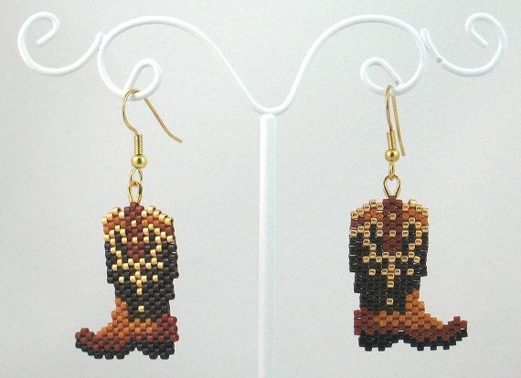 The item up for sale is a pair of beaded earrings. The design features a pair of gold-trimmed cowboy boots. The main portion of the earring is