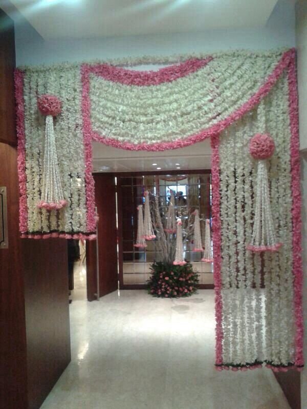 wedding home decoration entrance decor with florals for a pink and white theme 9696
