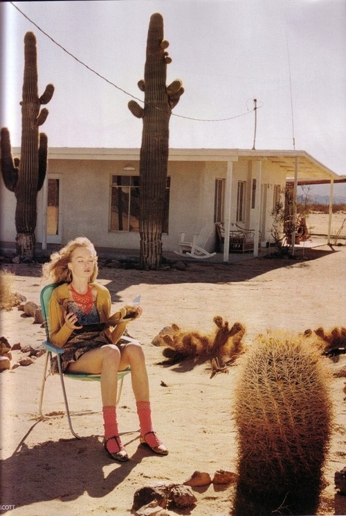 OMG. This could have been me at that age. Sitting in the desert trying to tan. LOVE this shot.
