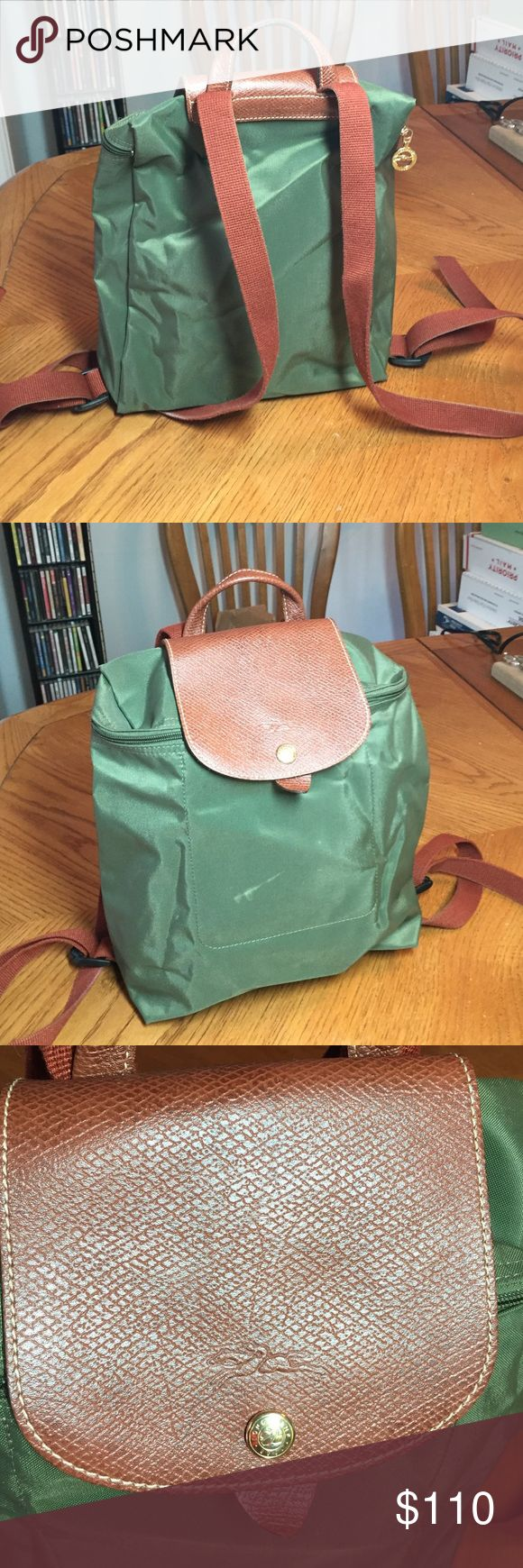 Longchamp green backpack Barely used. In great condition but has scratch on front pocket. Longchamp Bags Backpacks