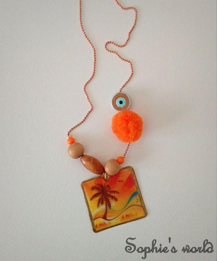 χειροποίητο κολιέ με ει΄κονα απο υγρό γυαλί, πομ πομ και ματάκι #handmade #necklace #sunset #pompom #summeraccessories https://www.facebook.com/SophiesworldHandmade/