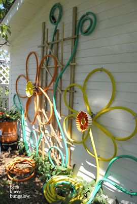 Don't toss those old or broken garden hoses.                 A Spring Wreath    source         Door Mat   source         Chair   source   ...