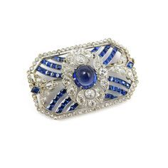 Belle epoque Ceylon sapphire and diamond brooch with central cabochon sapphire, French c.1910,