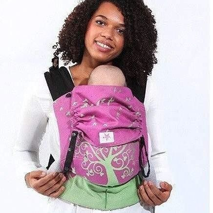 If you're anything like us you'll love the adjustability and ease of use of the Kokadi Flip. . Pretty in pink with the enchanting Ava in Wonderland print . . . [image of a dark skinned female with curly black hair. She is wearing a baby in a pink and green soft structured baby carrier. The carrier is called a Kokadi Flip and the design is Ava in Wonderland.]
