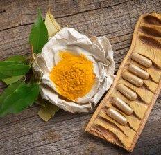 Natural herbal tumeric capsules with fresh herb leaves - Turmeric Tea