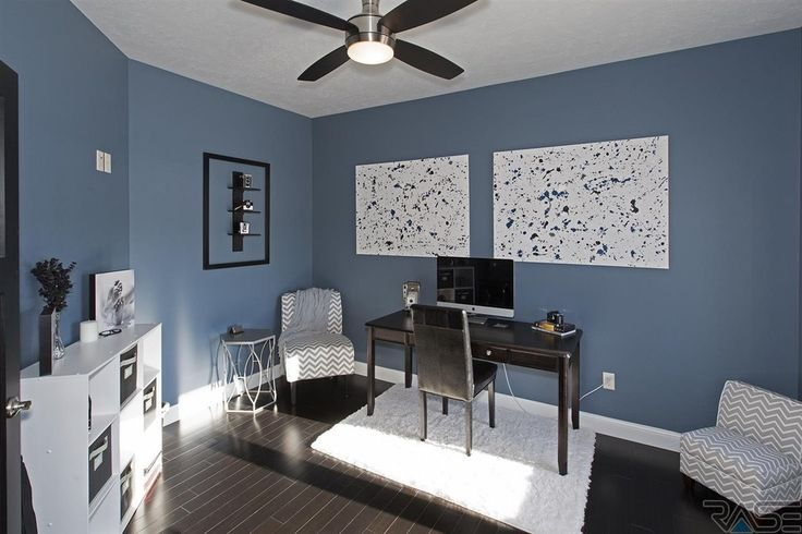 Contemporary Home Office with Hardwood floors, Ceiling fan